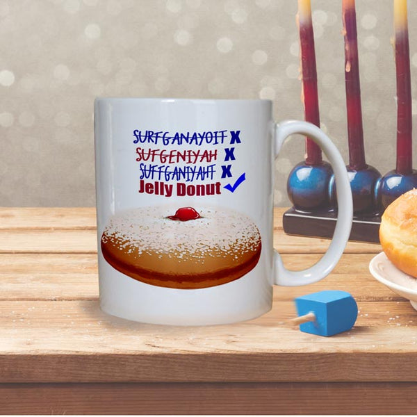 funny Hanukkah Mugs with Multiple wrong spellings for Sufganiyah with x and Jelly Donut with a check mark on ceramic coffee mugs
