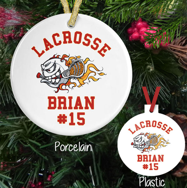 Flaming Lacrosse Ball holding a stick on a porcelain or plastic ornament personalized with any three lines of text.