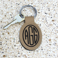 Three initial oval monogram on tan vegan leather key ring
