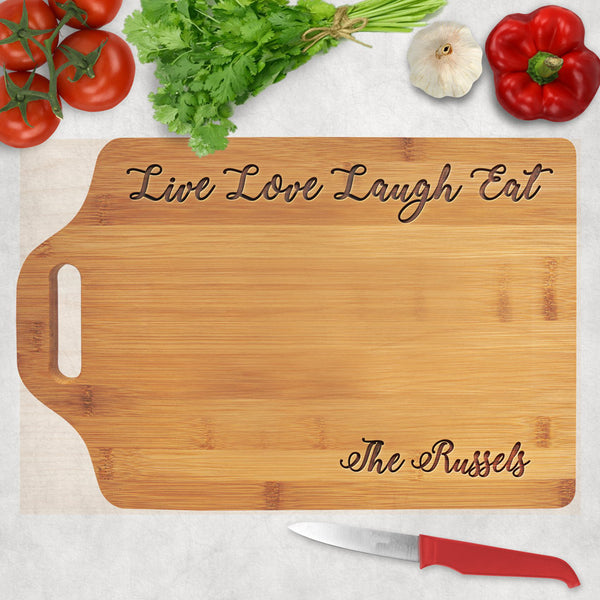 Bamboo cutting board with extension for slotted handle and Live Love Laugh Eat engraved along the top. Any name on the bottom right.