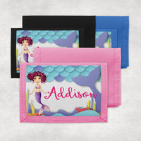 mermaid wallets offered in pink, blue or black