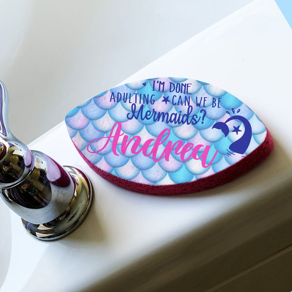 Oval Shaped Bath Sponge With Mermaid Scales and Tail Design Saying I'm Done Adulting, Can We Be Mermaids and personalized with your name.