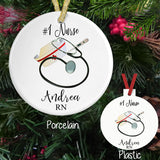 Personalized Ornaments with Nurse Cap, Stethoscope and Thermometer. Personalized on a Porcelain or Plastic Ornament with Text above and below the image. Your Choice of Font and Color of Text.