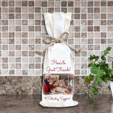 Photo of friends toasting at dinner party on a wine bottle gift bag with custom message