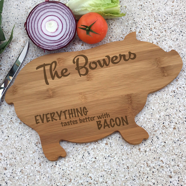Pig Shaped Cutting Board with personalized engraving on top and bottom leaving center free for cutting, however, chopping and dicing should be done on the non engraved side