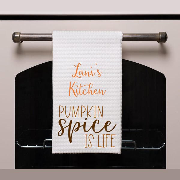 "waffle weave towel shown on an oven handle with personalization and design saying ""Pumpkin Spice is Life"""