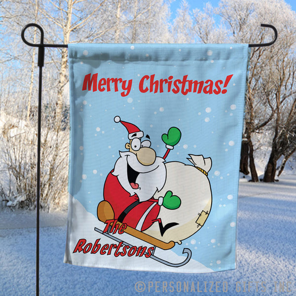Personalized Yard Flag with Santa sledding down a hill with personalized merry christmas greeting and any name
