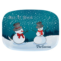 two snowmen on a snowy hill with trees and snow falling in the background.. Two areas of personalization.