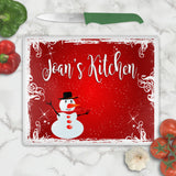 Glass cutting board with Snowman in red blistery background personalized with any name and your choice of font