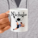 Personalized Ceramic Mug with Soccer Player extending leg to kick ball and name printed above half ball