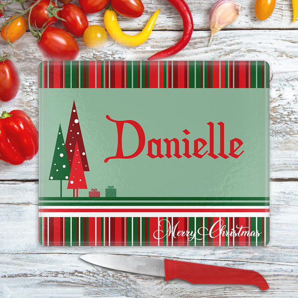 Christmas stripes on top and bottom with gift boxes and triangle christmas trees on left center of a solid back along with any personalized name and send line of custom text