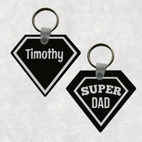 Daimond-Pentagon Shaped Key Ring Black Background with silver-gray super hero outline and Super dad on one side Personalized name on other side