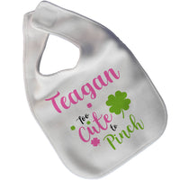 White velcro closure baby big with shamrocks in pink and green  along with any name and quote saying too cute to pinch