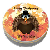 Round Gift Tin with Pilgrim Turkey on Fall Leaves Backdrop and two lines of personalized text.