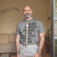 Veteran Valor design shown on a gray tee shirt Veteran in gold and the rest of the text in black