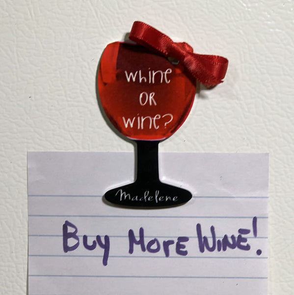 wine glass shaped magnet says whine or wine with a name both text areas can be personalized