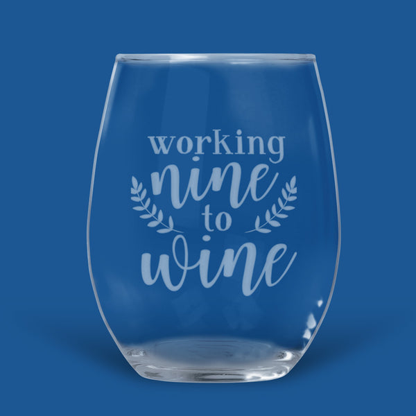 stemless wine glass engraved with Working nine to wine