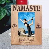 4 x 6 yoga design wood picture frame tall view of Namaste on top Ohm Symbol on left and meditator sitting in lotus position on right. Personalized 2 lines of text on bottom