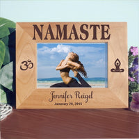 4 x 6 yoga design wood picture frame wide view of Namaste on top Ohm Symbol on left and meditator sitting in lotus position on right. Personalized 2 lines of text on bottom