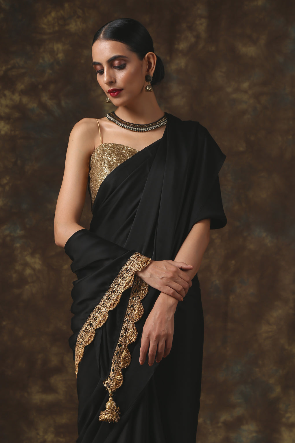 Luxurious Black Satin Saree with Dull Gold Lace and Pendants