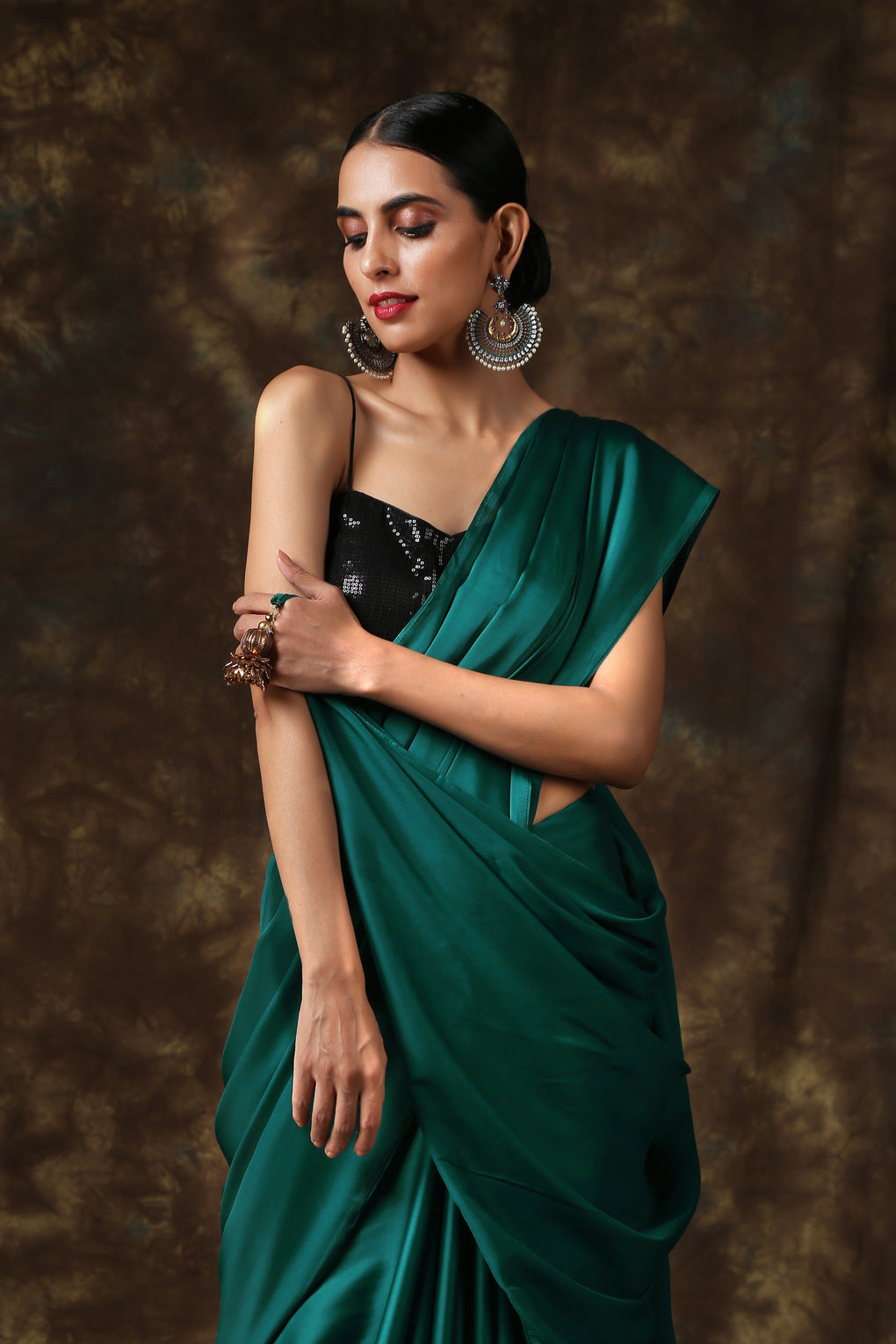 Rich Emerald Green Satin Saree with Bronze Pendants