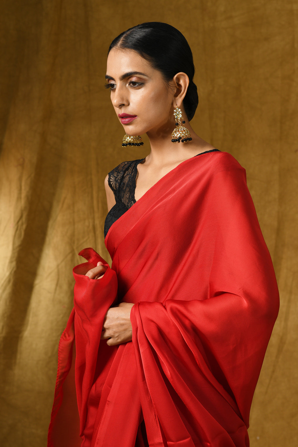 Fiery Red Satin Saree with Gold Pendants