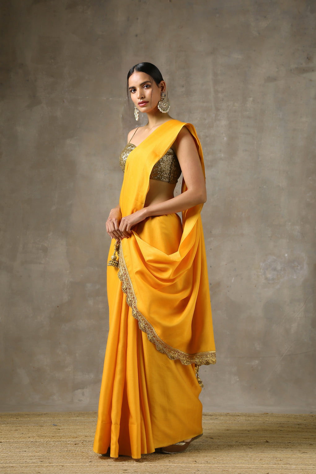 Ochre' Saree with HandMade lace on edge with Pendants