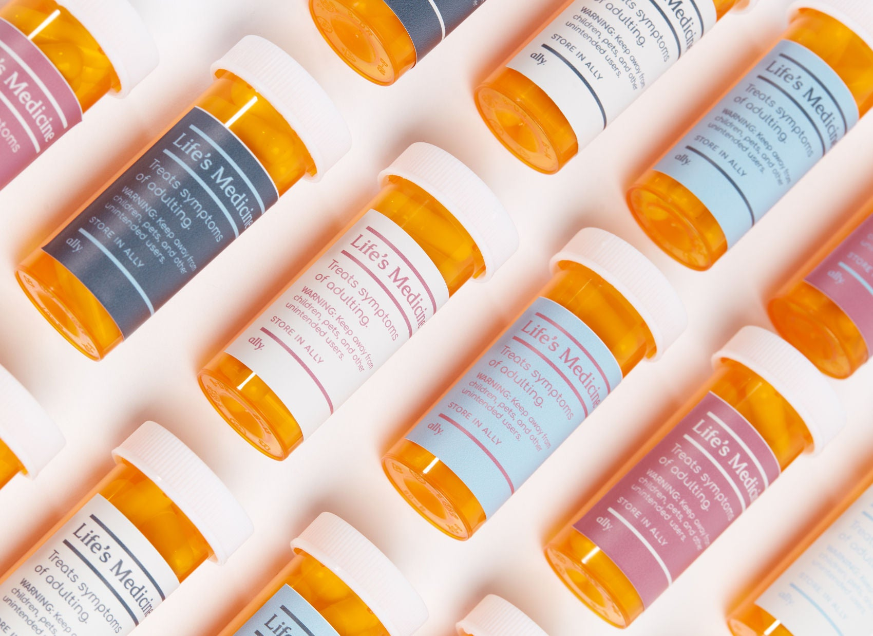 Pill bottles labelled with: Life's Medicine. Treats symptoms of adulting. Keep away from children and other unintended users. Story in your Ally.