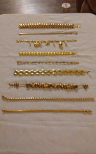 A 9 piece gold tone bracelet lot - B&P'sringsnthings