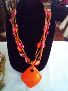 A four tier orange colored necklace - B&P'sringsnthings