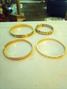 Dressy lot of 4 gold tone bracelets - B&P'sringsnthings