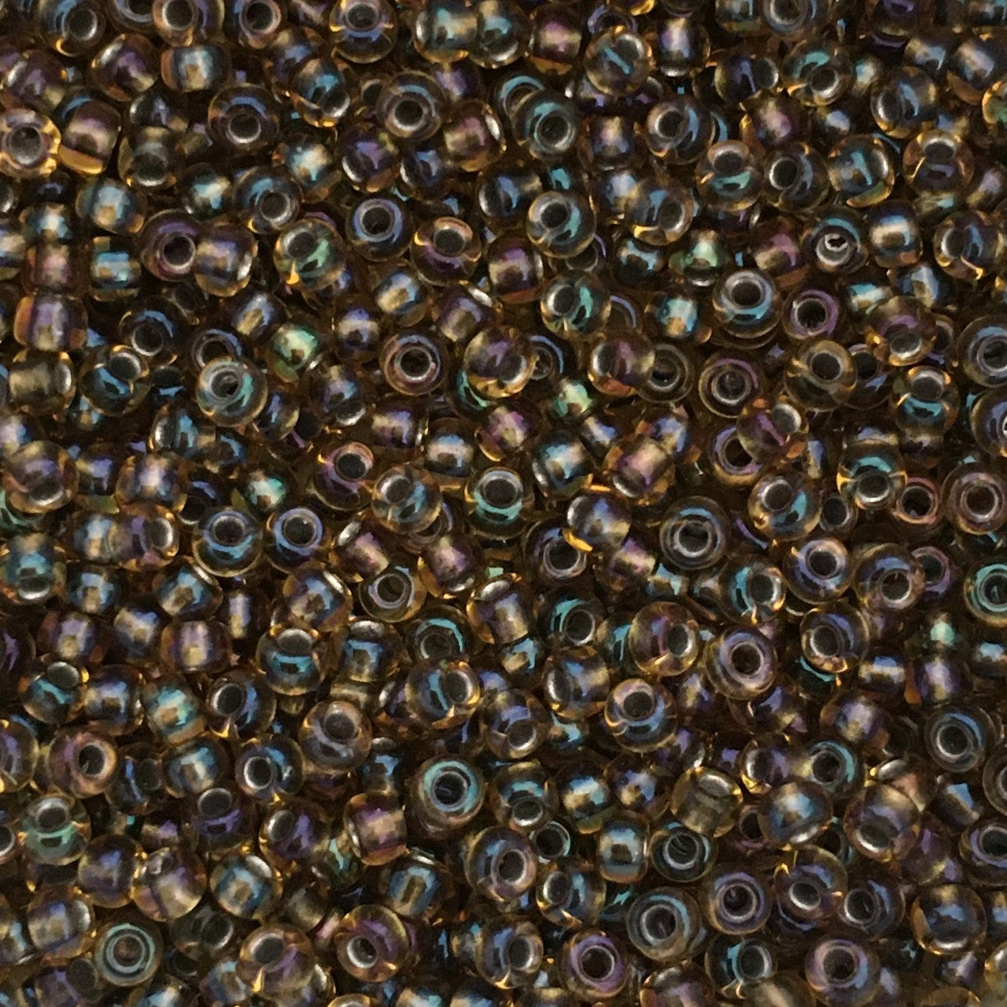 Toho Seed Beads size 11/0  Black-lined Smokey Topaz Rainbow TRD-281