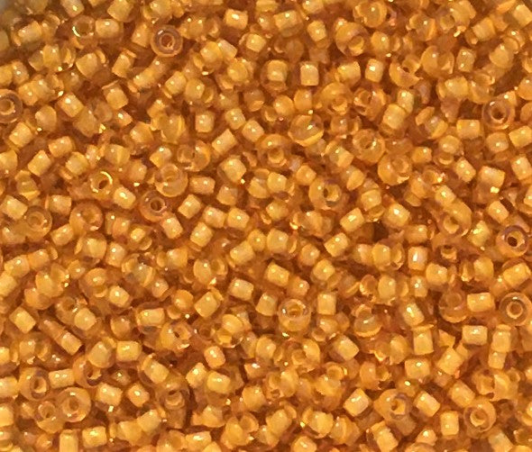 Toho Seed Beads size 15/0  Transparent Gold/White-lined TRD-949