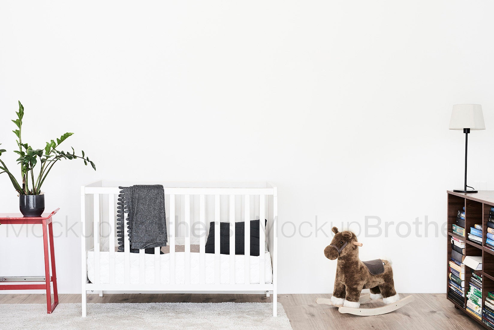 Nursery room with blank white wall by MockupBrothers