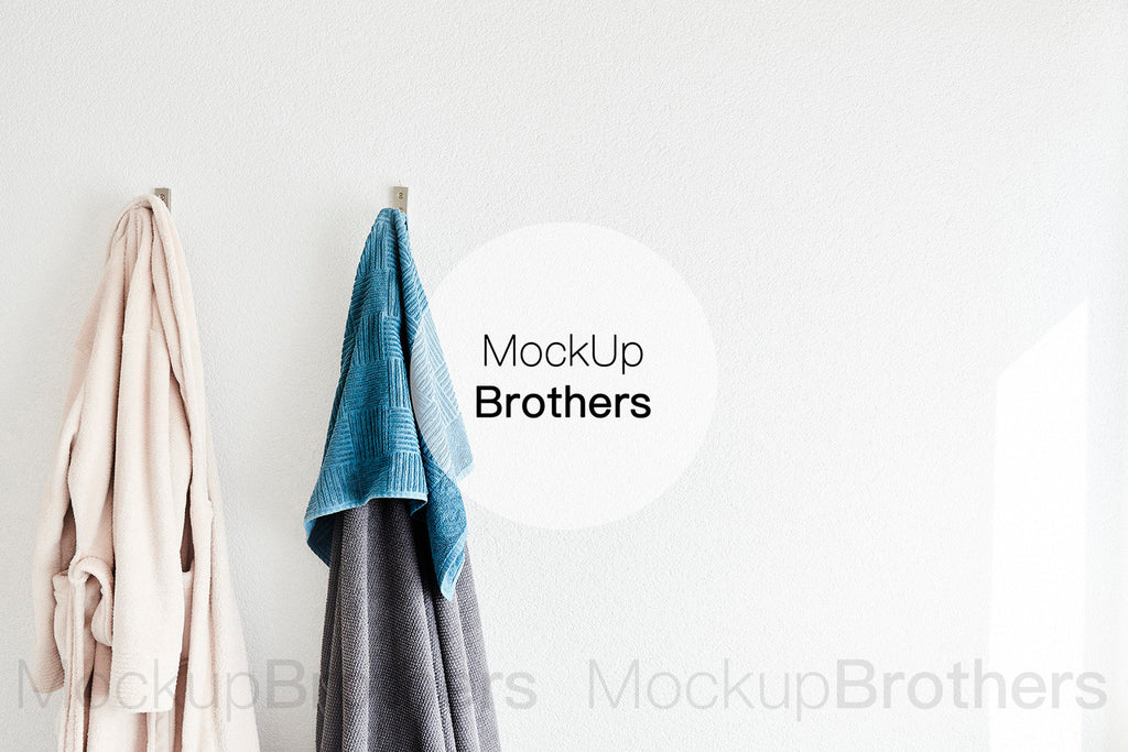 Bathroom wall mockup with towels by mockup brothers