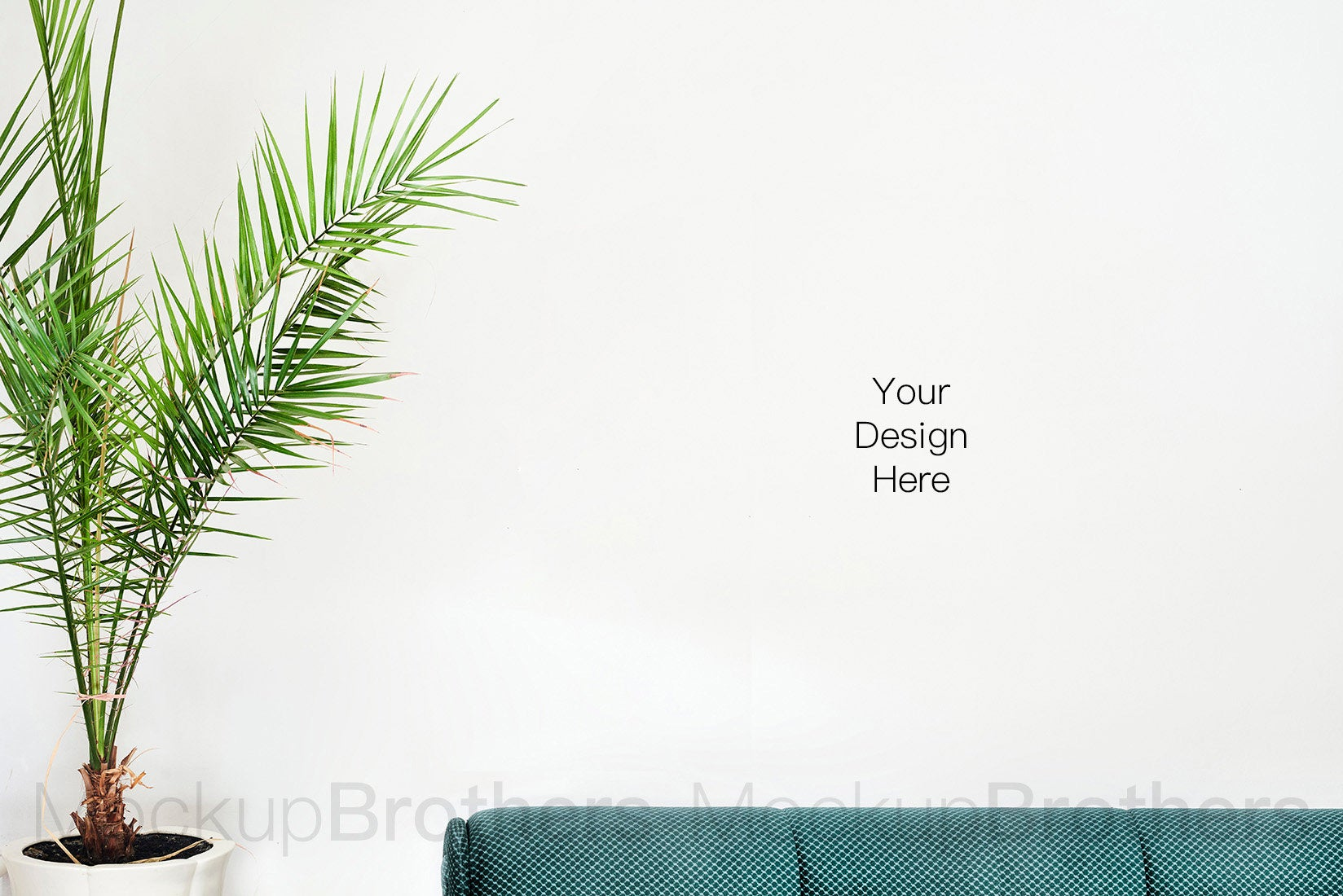 Blank wall mockup with sofa and palm tree