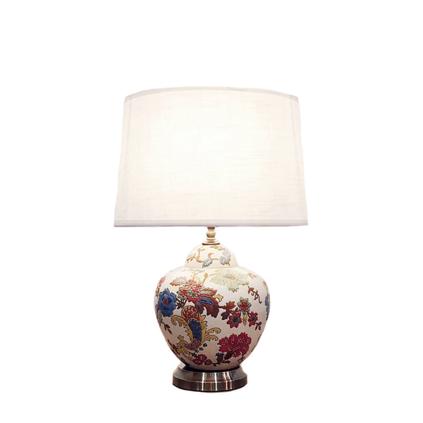 Round ceramic table lamp with metallic base