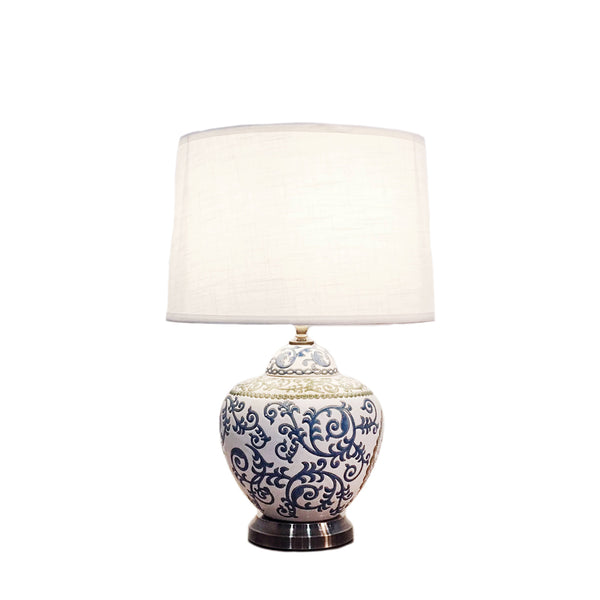 Round ceramic table lamp with a white base
