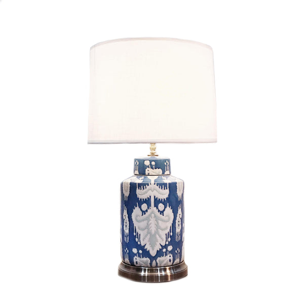 Round ceramic table lamp with a blue base