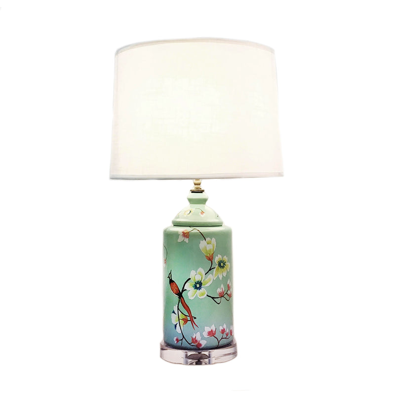 Round ceramic table lamp with green base