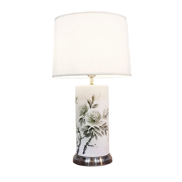 Tall cylindrical ceramic table lamp with white background