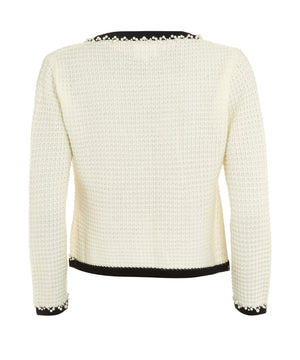 back of French style little white knitted jacket as inspired by Coco Chanel
