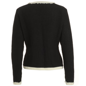 Back view of Annie Jacket inspired by the legendary Coco Chanel. Black with creamy white edging and pearl and diamante trim