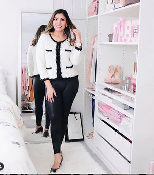 Little French knitted Jacket in white inspired by Coco Chanel modelled by Fabiola and paired with black skin-tight leggings