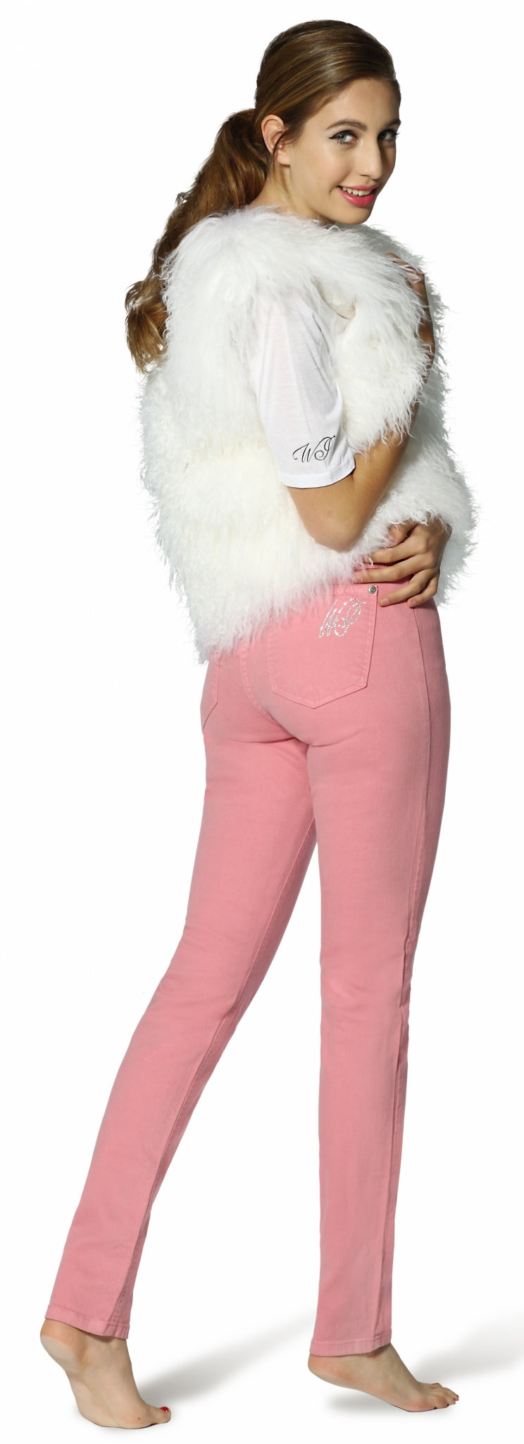 pocket view of womens skinny cut jeans in pink