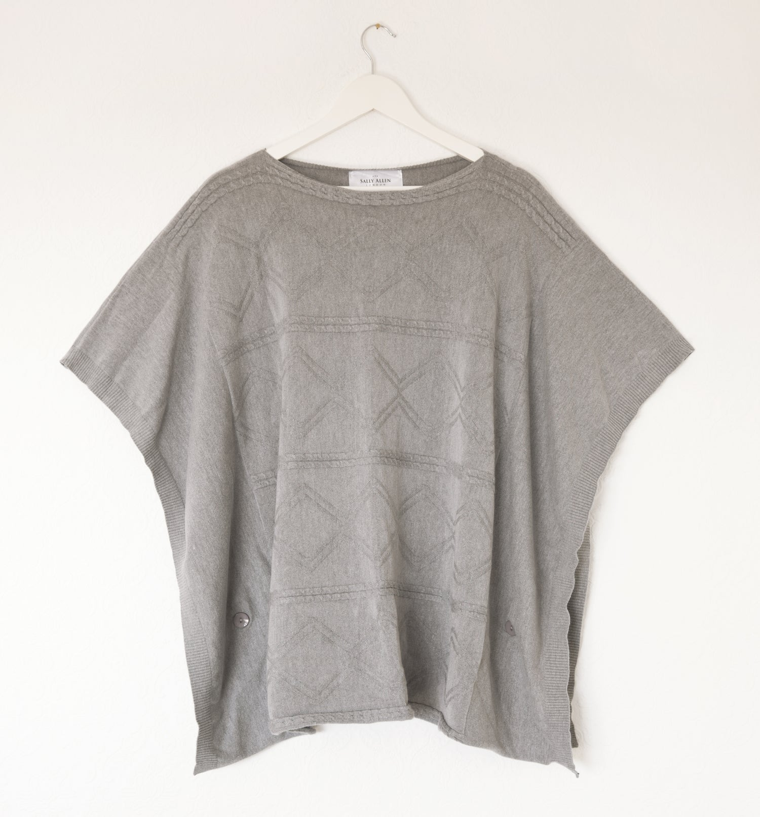 knitted poncho in silver grey