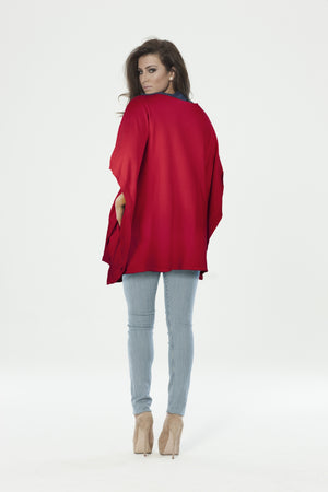 back of red knitted poncho