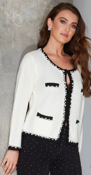 Angie White knitted jacket inspired by the legendary Coco Chanel and paired with black diamante party jeans
