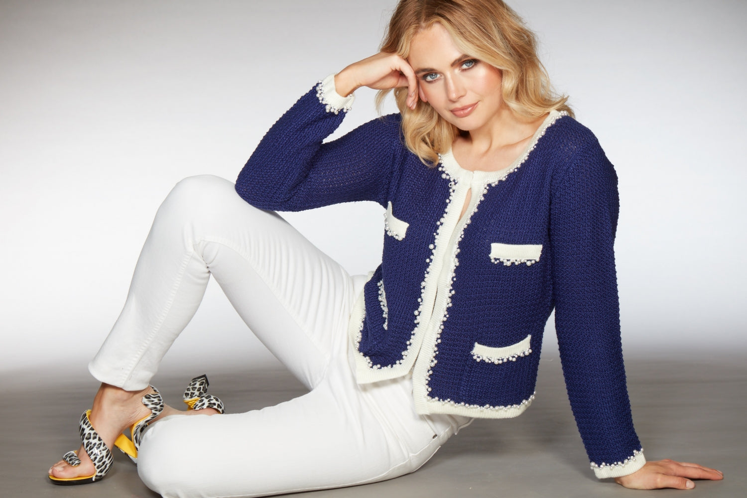 Malibu White Womens skinny cut Jeans styled with Coco Chanel inspired little french knitted jacket in royal blue and leopard print shoes by Julian Hakes