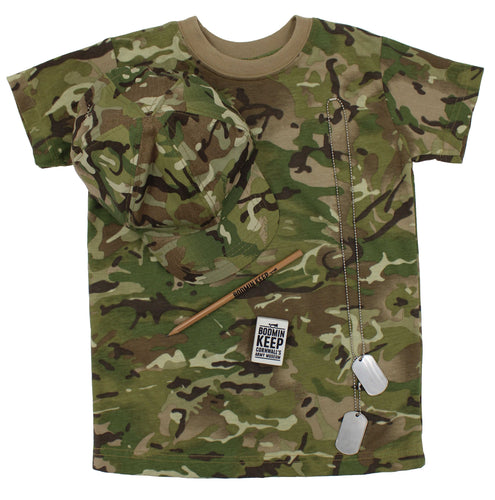 Image shows a camouflage t-shirt of light greens and browns, on top of this is a baseball cap in the same colours, there is also a Bodmin Keep: Cornwall's Army Museum logo pencil and eraser and a set of metal dog tags on top of the t-shirt.